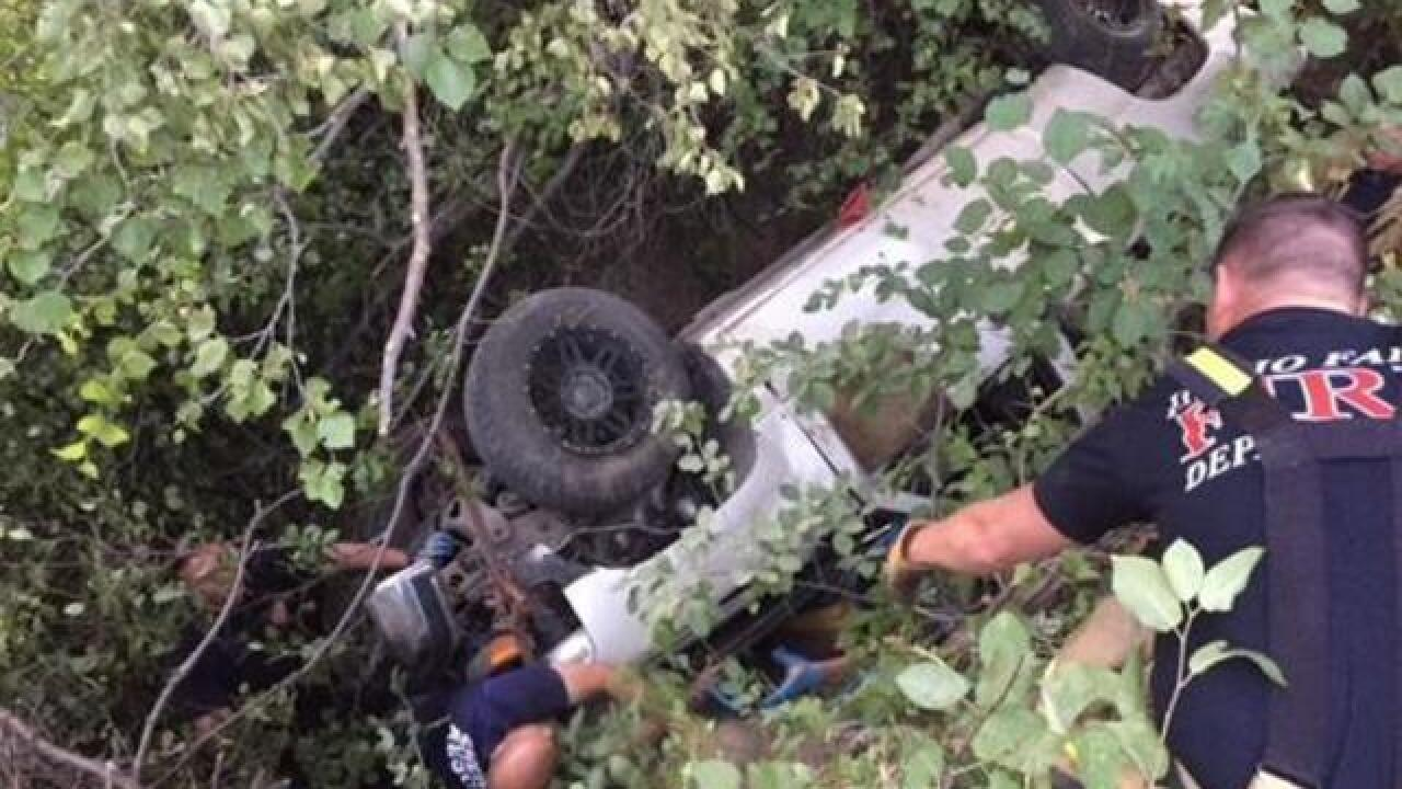 Rescuers free man trapped under truck for at least 2 days