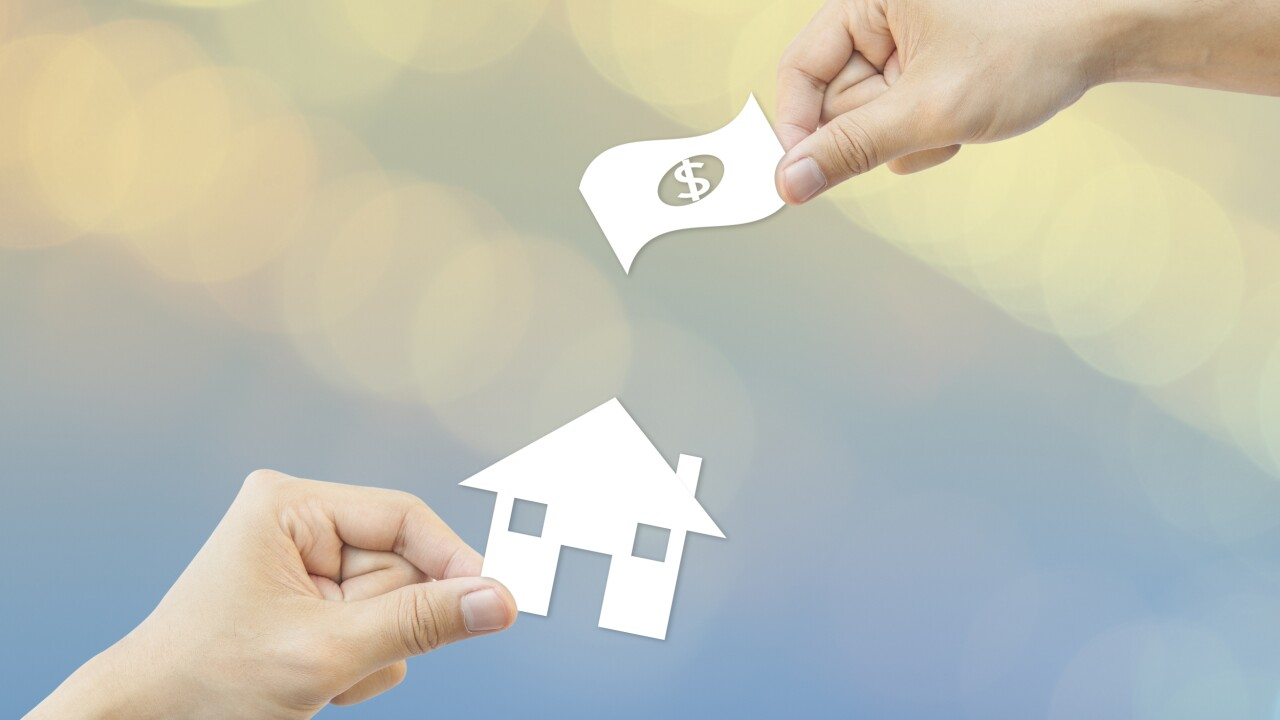 Business concept Hand hold white paper house and money bokeh bac