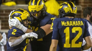 Blake Corum, Andrew Stueber, Cade McNamara Michigan Football