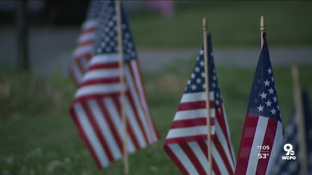 Small American flags line the curb of a road in Northern Kentucky.