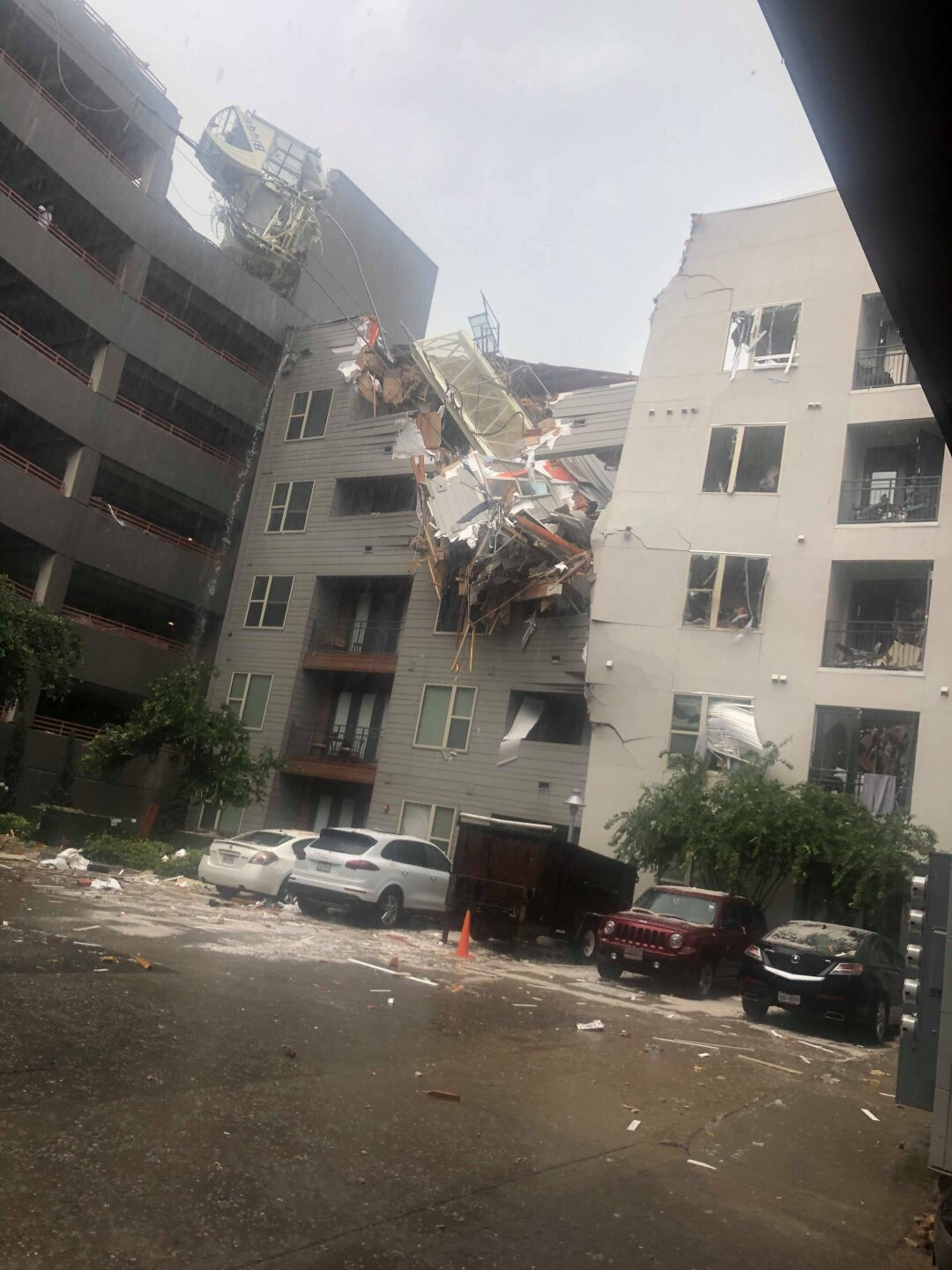 Photos: At least 1 dead, 6 injured after crane falls on Dallas apartment building