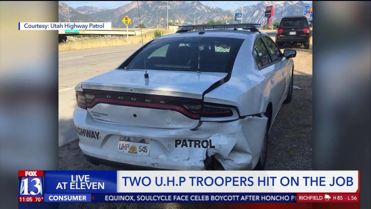 Two Utah Highway Patrol troopers hit in their cars in separateincidents