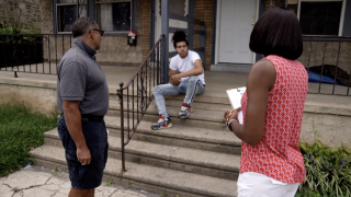Ann Cunningham and Terry Booker are on a mission to get accurate information out to people about the COVID-19 vaccine. They are seen here speaking to a resident in Coatesville, Pennsylvania.