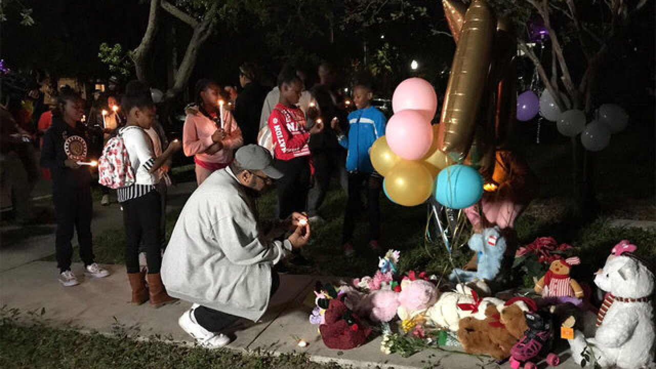 Community remembers WPB double murder victims during candlelight vigil