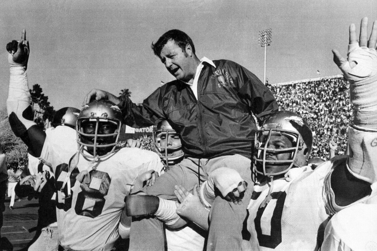 Florida State Seminoles head coach Bobby Bowden carried off field after 37-9 victory at Florida Gators in 1977