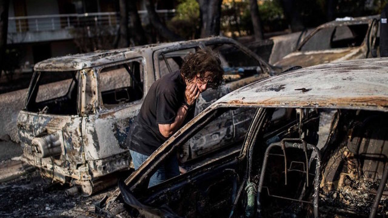 Cars turned to molten metal as Greek wildfires wipe villages off the map