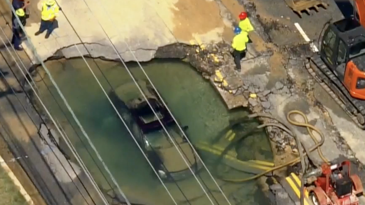 Chopper footage shows car completely submerged in gigantic sinkhole off Crain Hwy