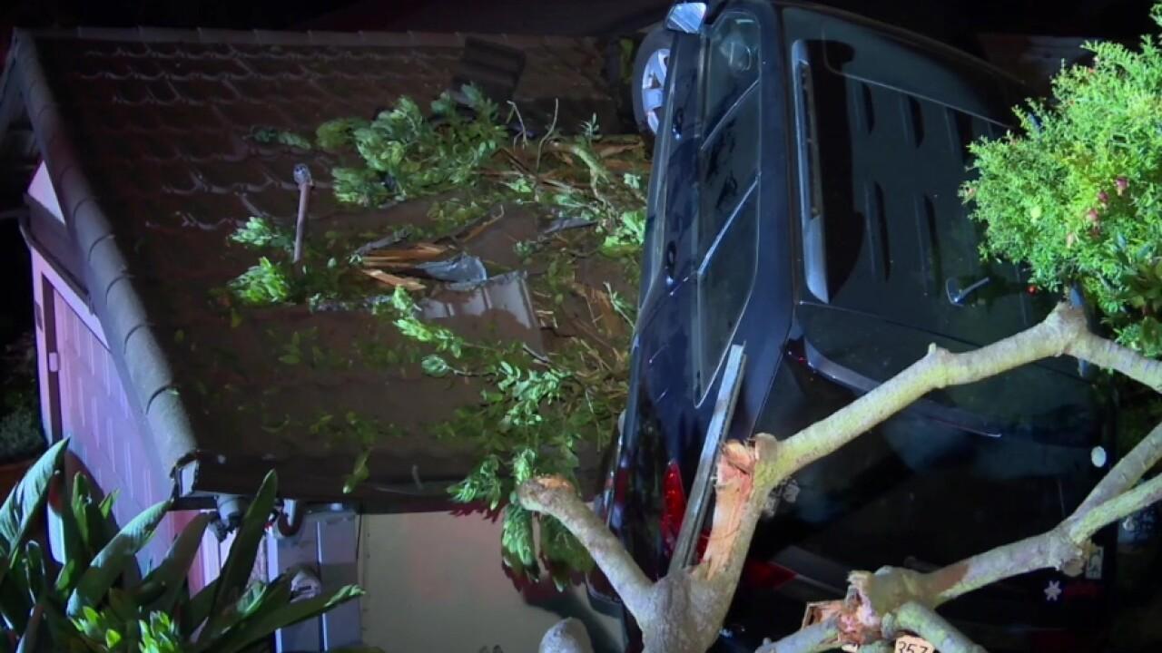 SUV crash lands on roof of University City home