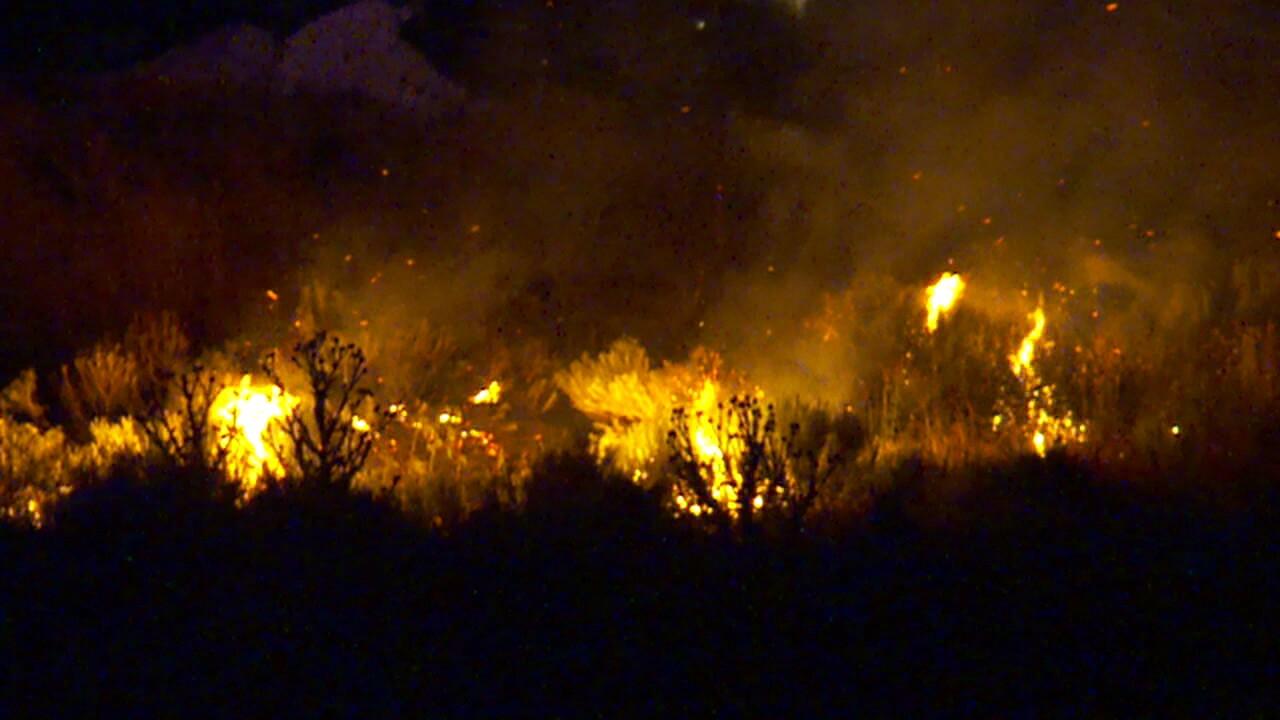 Fireworks hits police car, spark field fire inHerriman
