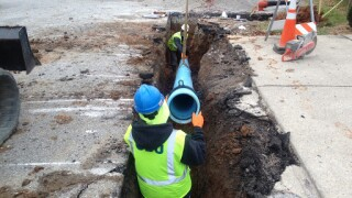 Crews work t repair and replace water main pipes in Bloomington