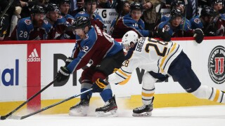 Girgensons battles along the wall as Sabres take on Avs