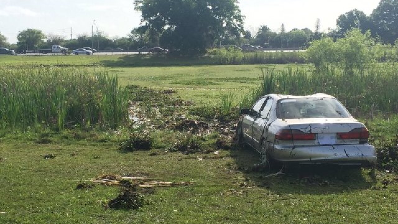 Crews search for car submerged in St. Pete pond
