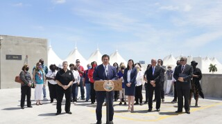 Gov. Ron DeSantis surrounded by Ashley Moody, Miami-Dade County officials and cruise workers at PortMiami, April 8, 2021