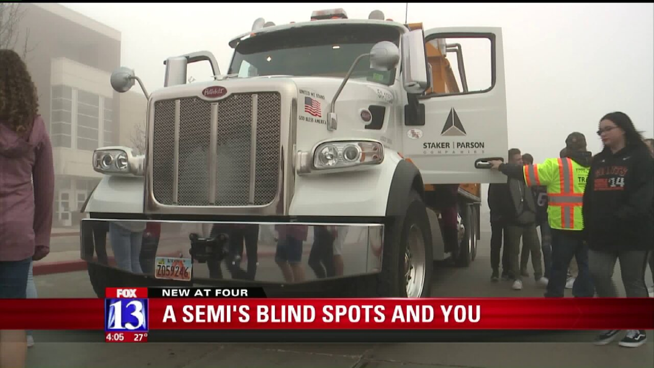 Students and parents learn about semi trucks, and their blind spots