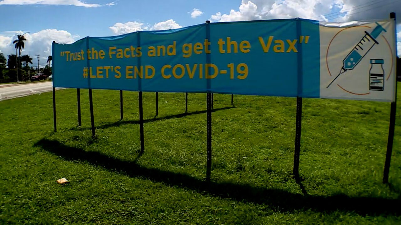 Sign around Belle Glade urging people to get vaccine
