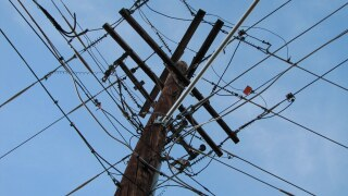 A power pole with electrical wires and cables.