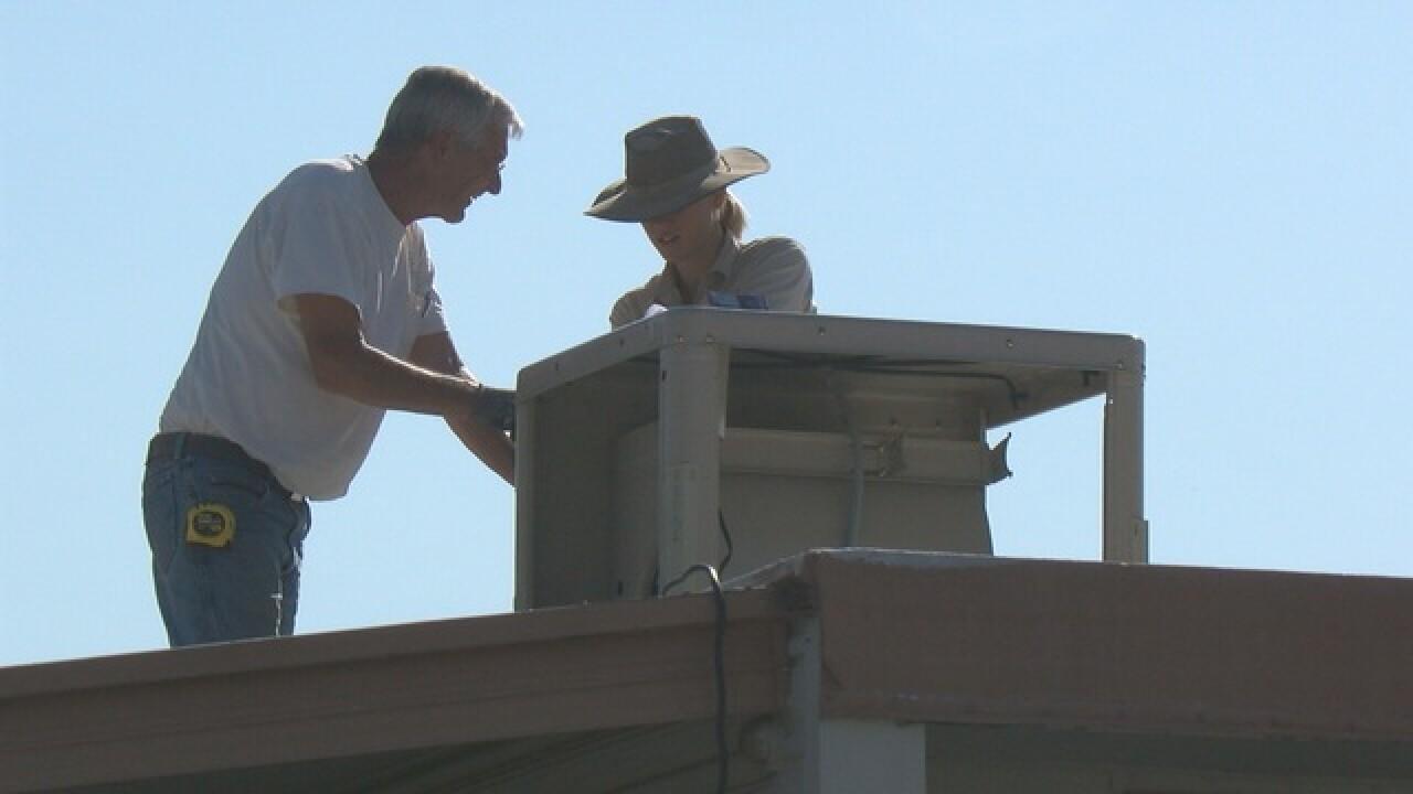 In record heat, volunteers needed to help repair coolers