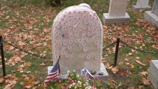 Shield protects Susan B. Anthony's headstone from voting stickers left in her honor