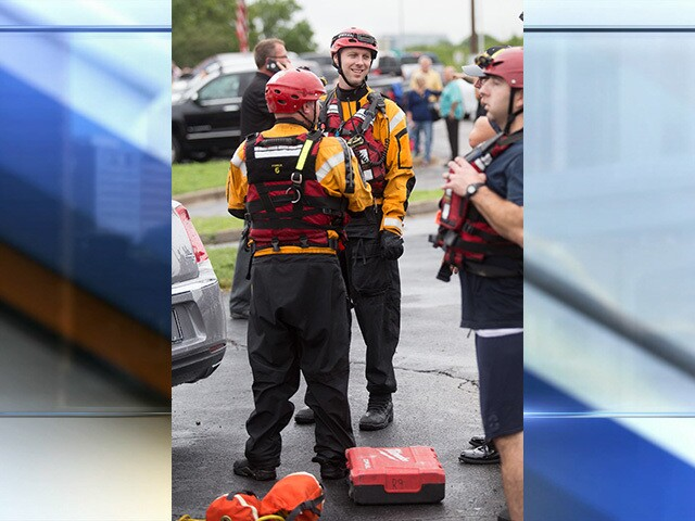 PHOTOS: Coach's Bar & Grill owners rescued after restaurant floods