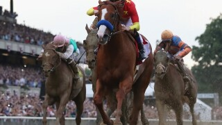 Justify captures Triple Crown with win in Belmont Stakes