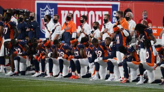 broncos kneel during national anthem before 2020 season opener against titans.jpg
