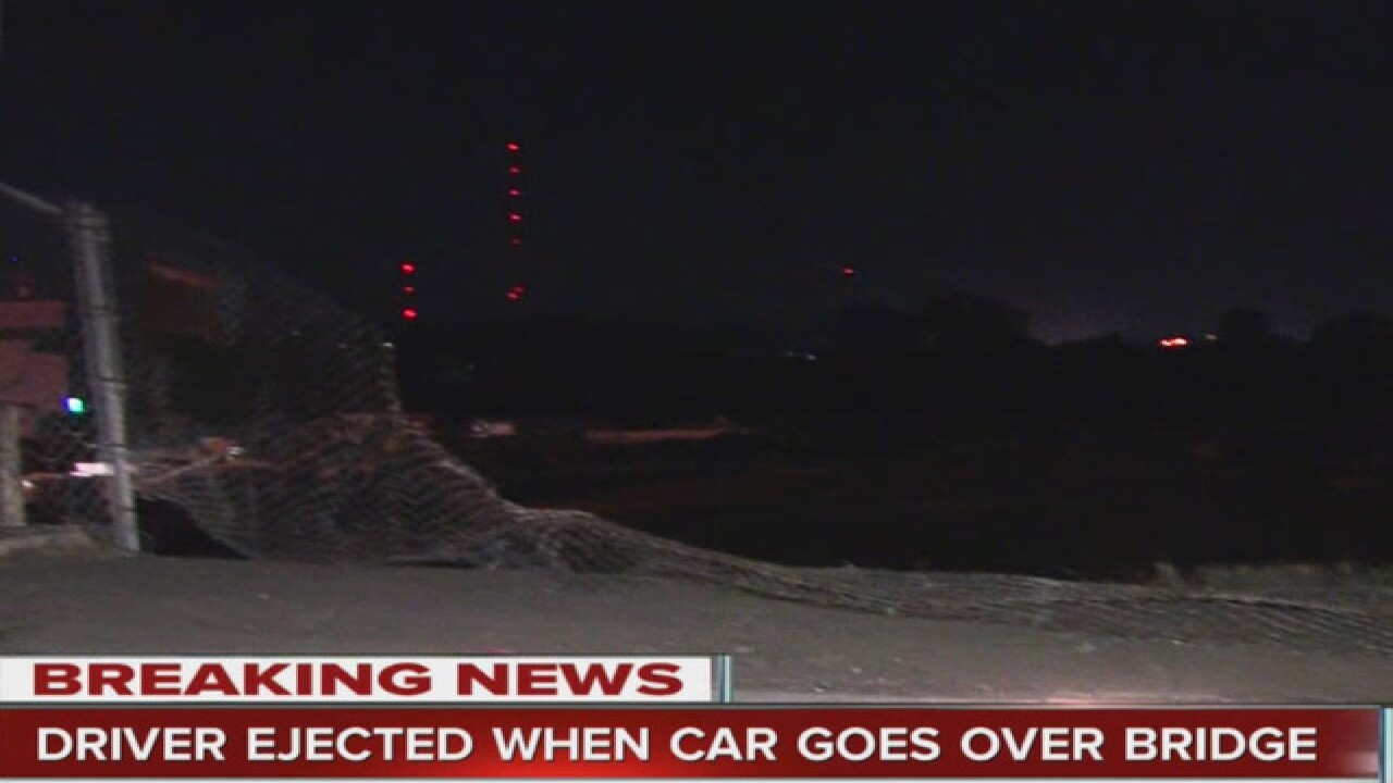 One dead after car drives off bridge in east KC