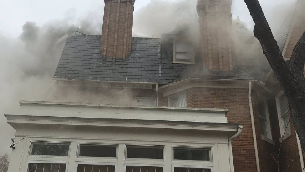 Norfolk firefighters respond to three-story housefire