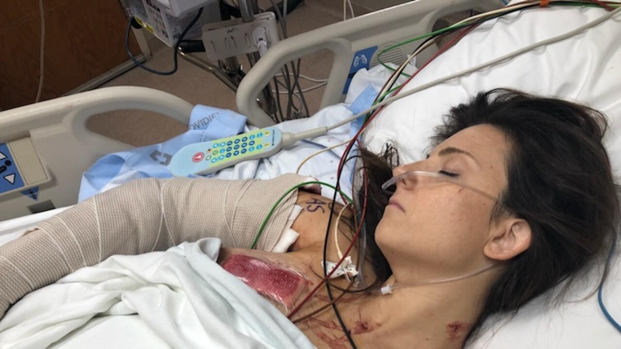 Whitney_Austin_in_hospital_bed.JPG