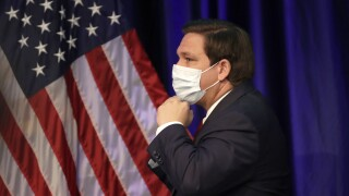 Gov. Ron DeSantis puts on mask, June 19, 2020