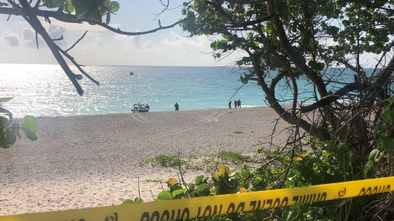 Authorities investigate the discovery of a body that washed up on Jupiter beach on May 12, 2021 (1).jpg