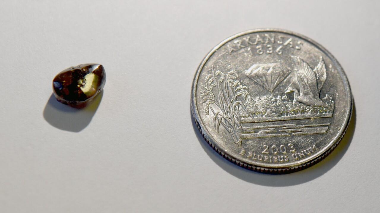 A vacationing teacher finds a 2.12-carat diamond at an Arkansas state park