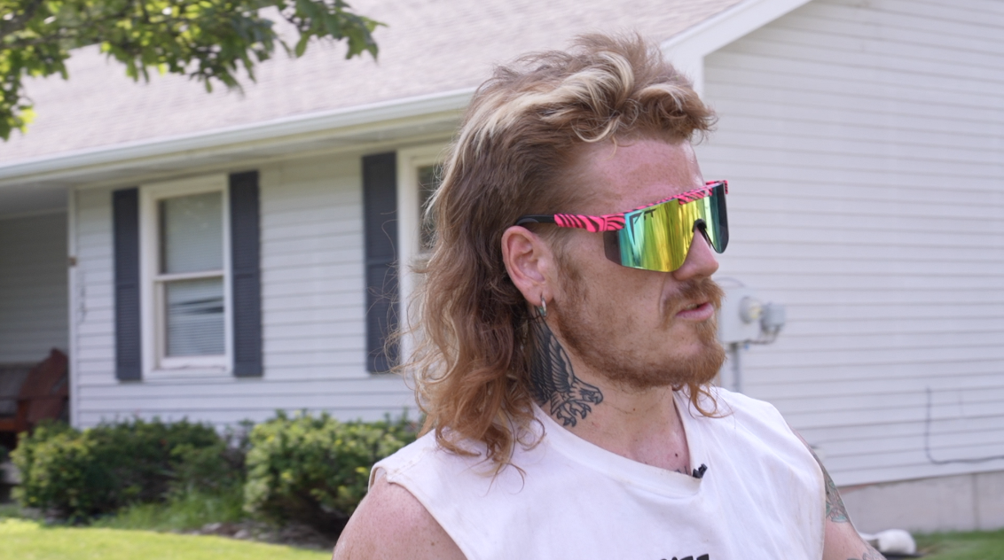 Guy with a mullet landscaping