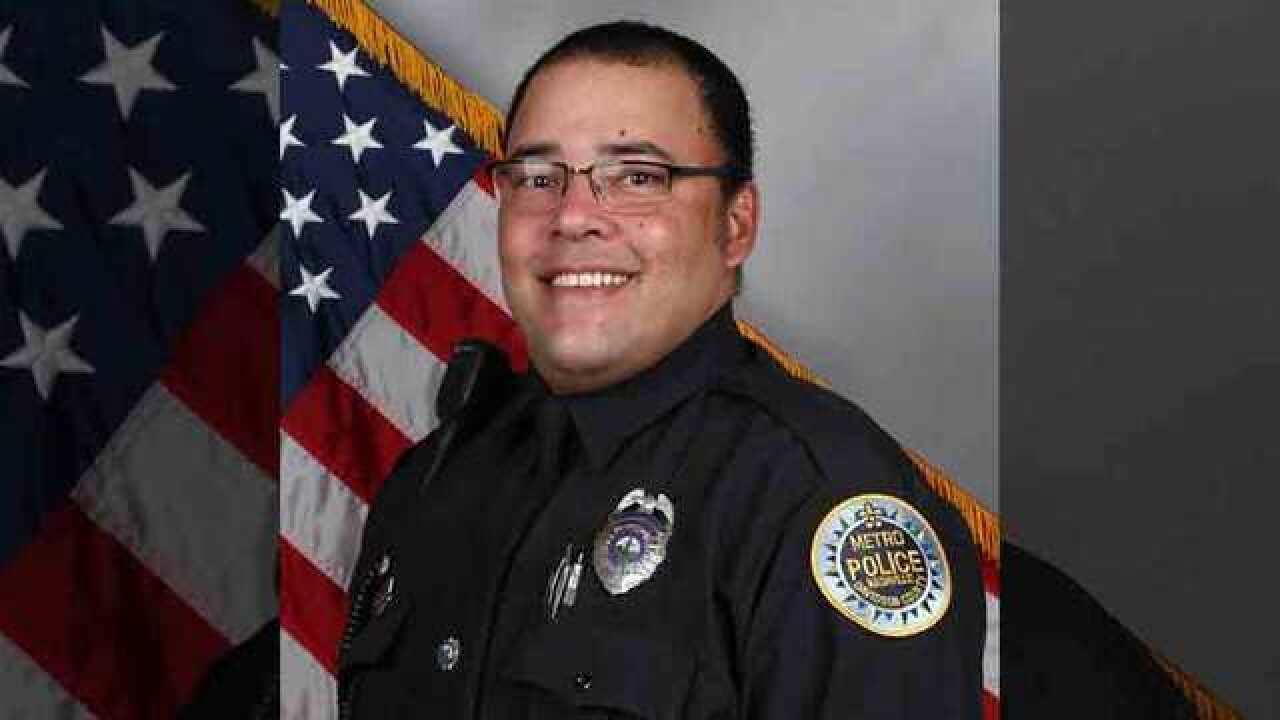Community Mourns Death Of Officer Eric Mumaw