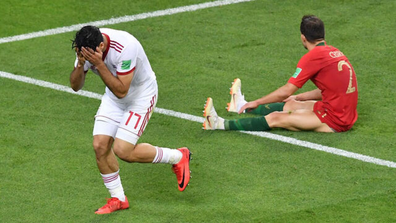 Spain and Portugal through after incredible Group B climax in World Cup