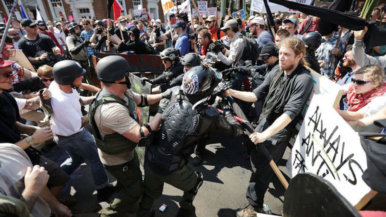 Feds arrest 4 members of white supremacist group for 'acts of violence' at Charlottesville rally