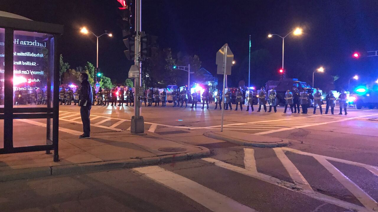 Crowd marching west on North about to meet this line of police at Wauwatosa Ave