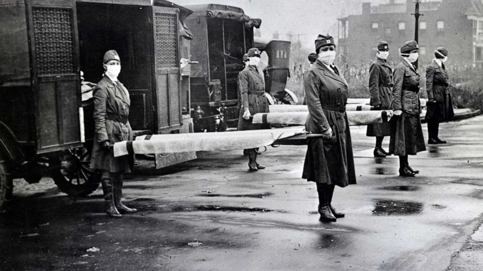 Universal Images Group via Getty Images, FILE Red Cross Motor Corps are on duty during the Spanish Influenza epidemic in St. Louis in 1918.