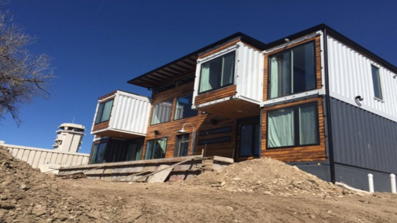 Couple uses 9 shipping containers to build home