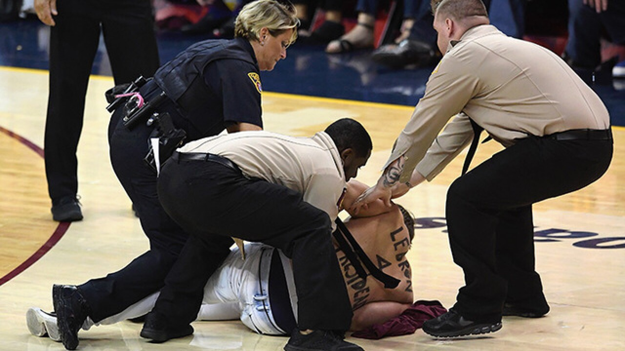 Shirtless man tackled after running onto court