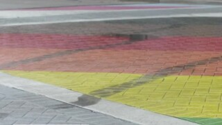 A vandalized LGBTQ Pride intersection and crosswalk at Northeast First Street and Northeast Second Avenue in Delray Beach on June 18, 2021.jpg