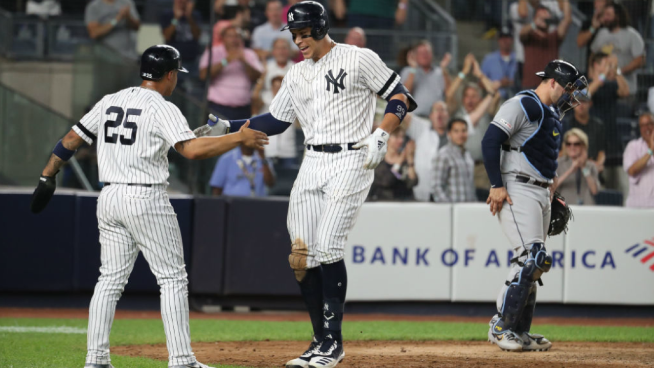 Aaron Judge celebrates with Gleyber Torres