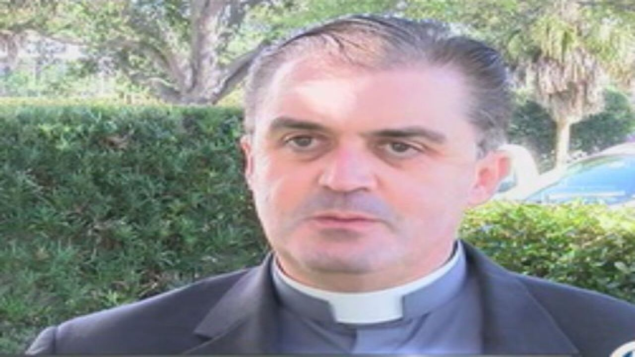 Priest says he was targeted for whistleblowing