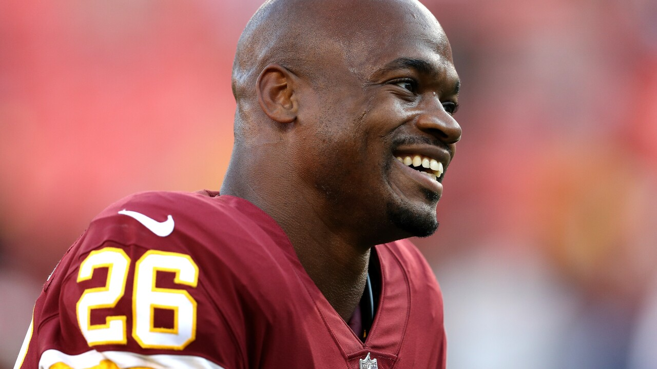 Photos: Welcome AD-dition: Adrian Peterson excites in Redskins debut
