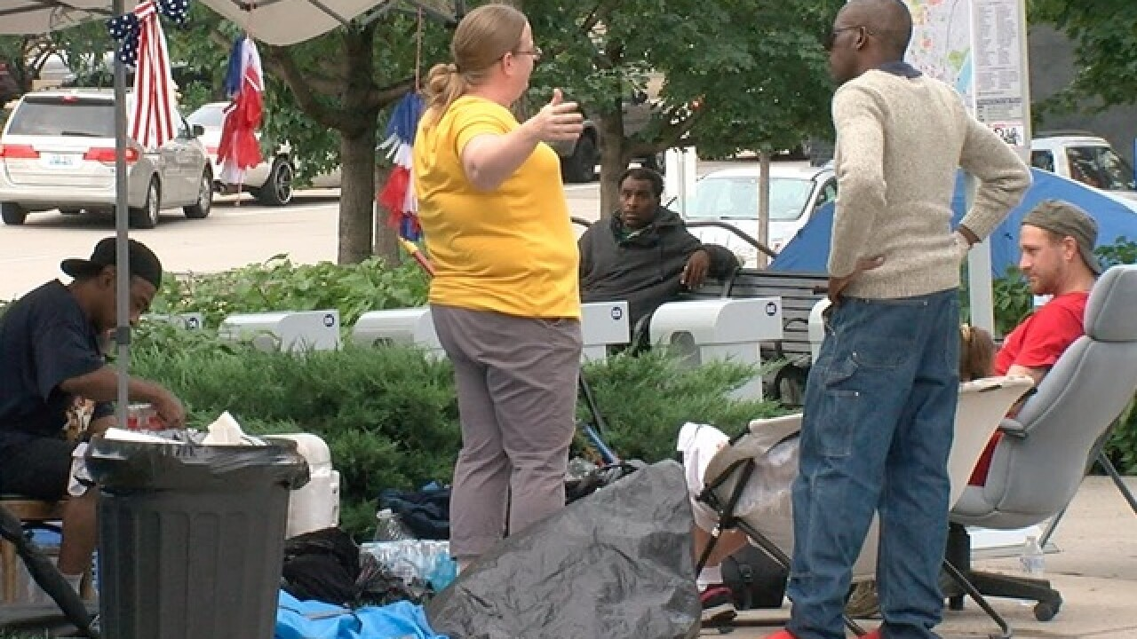 Homeless move, but say they won't disappear
