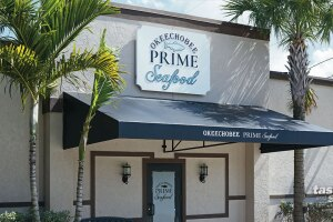 Third-generation Okeechobee Steakhouse owners Ralph and Laura Lewis along with senior and junior members of the Lewis family are opening Okeechobee Prime Seafood on Friday, March 5.