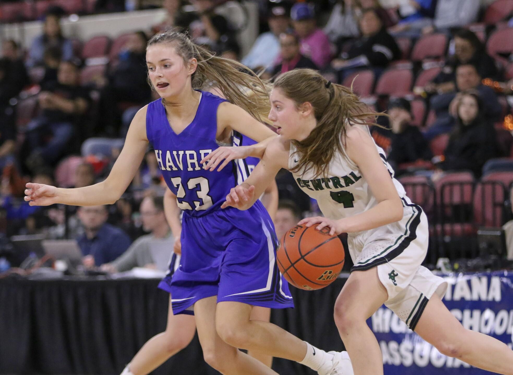 Mya Hansen moves the ball up the court as Jessa Chvilicek defends.jpg