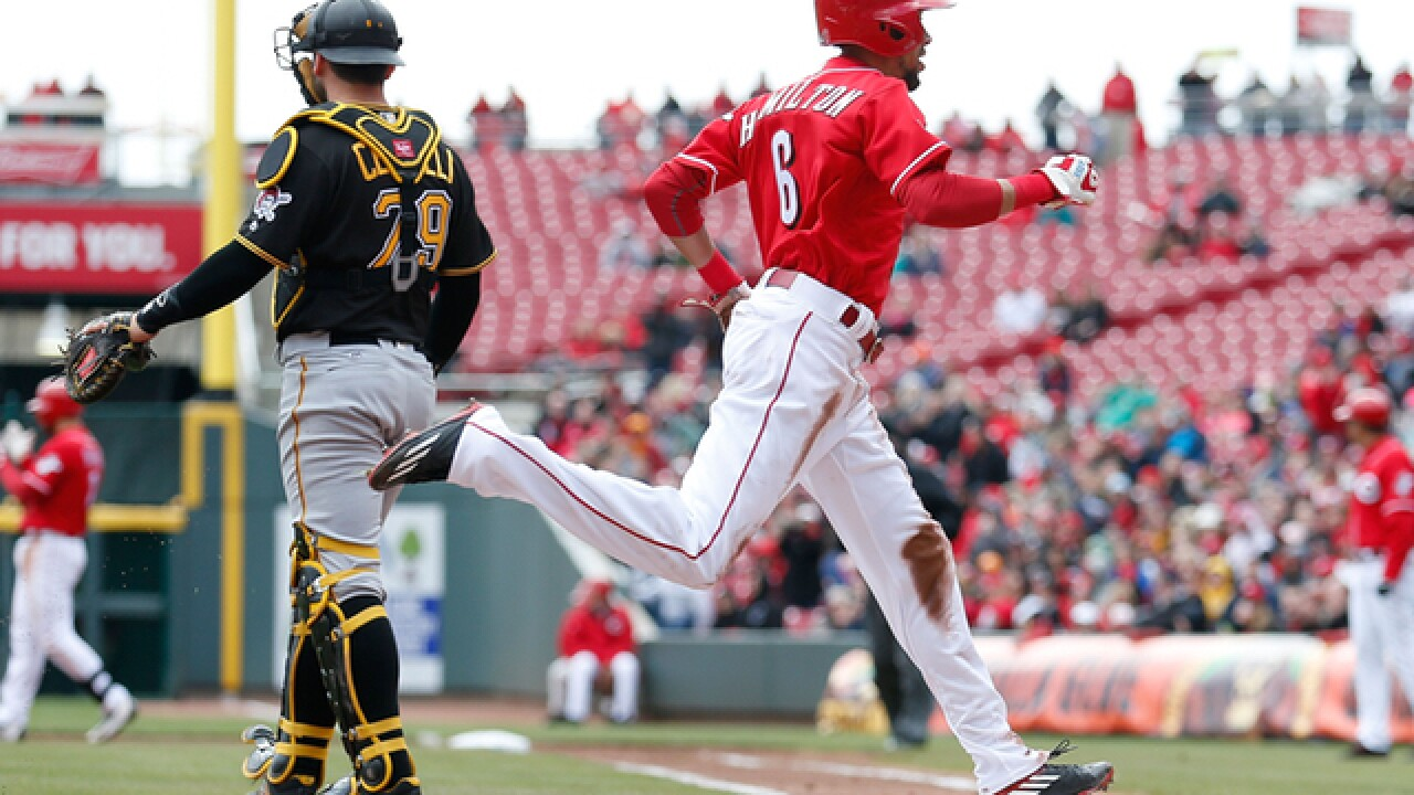 Reds send Pirates to their 1st loss, 5-1