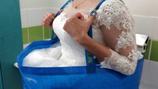 This Bride Used An Ikea Shopping Bag To Help Her Use The Bathroom In Her Wedding Dress
