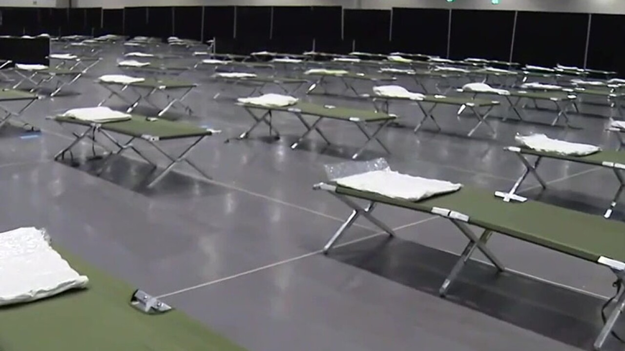 convention_center_migrant_children_beds.jpg