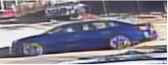 Police Looking for Blue Sedan